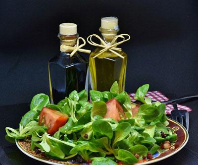 oil and vinegar cruets and salad
